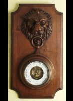 Wooden case with carved lionhead.