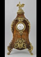 Antique french watch stand with front of an antique oignon watch. ca 1730