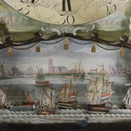 Longcase clock by 'Gerrit Vos, Amsterdam', with ships automation and fishing man under the ring.
