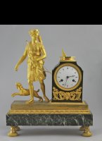 Gilded mantelclock, godess 'Diana' the hunters with sundial.
