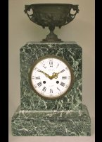 Green marble mantel clock with a bronze vase on top, signed 'Raingo Frères á Paris'.