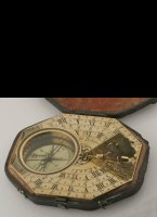 Large brass pocket sundial in original box with adjustable gnome and changeable magnetic declination hand under the compass needle. 96 x 83 mm