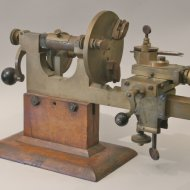 Antique watchmakers lathe on wooden basement