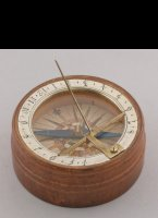 Wooden sundial with silvered brass hour-ring, copper engraving as windrose, brass gnome. Original paper box with ink written year 1780 on it and some Declination instructions. Box 60 x 23mm.