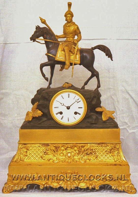 Charles X gilded and patinated mantle clock with on knight horseback. ca 1830-40