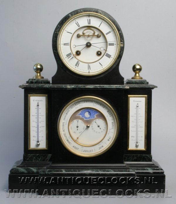 Black marble (Noire Belge) mantelclock with perpetuel kalendar, day- month- and moon-indication and automated leap-year or (bissextile) correction. 2 enamel thermometers, visible Brocot escapement. ca 1860.