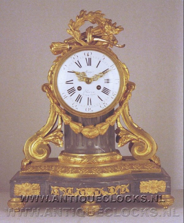 Grey marble and gilded casted brass mantelclock, signed: 'Mage à Paris, 59 Rue de Provence'. ca 1850.
