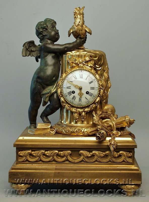 guilded brass casted clock with cherub and coq or chicken