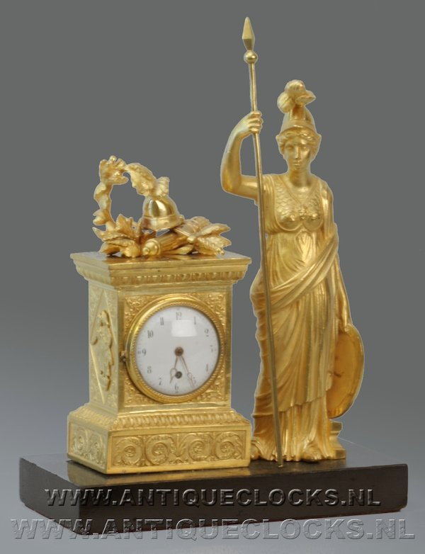 guilded miniature clock with watch movement and Athene figure